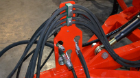 Hydraulic pipes and electric cables are kept neat on the drill.